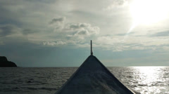 View from a small wooden boat as it sails over smooth seas. - stock footage