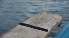 Detail shot of a wooden boat, water rushing past in the background as it sails. Stock Footage