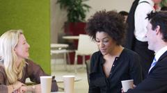Coffee break meeting. Corporate office business people. Businessmen and - stock footage