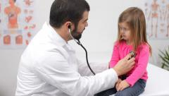 Doctor with young patient - stock footage