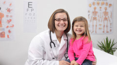 Female doctor with young patient - stock footage