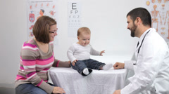 Doctor gives baby a checkup - stock footage