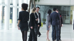 Stock Video Footage of Corporate office business people. Businessmen and businesswomen in the city