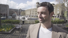 Portrait of a young handsome man outdoors in the city - stock footage