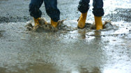 Stock Video Footage of Two young boys jumping in mud puddle