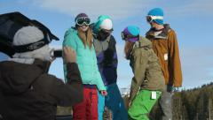 Group of snowboarders take picture together - stock footage