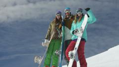 Group of young snowboarders on the slopes - stock footage