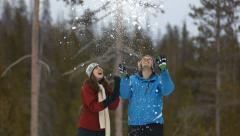 Couple playing with snow Stock Footage