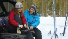 Couple getting ready to go cross country skiing - stock footage