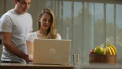 Blonde woman using laptop at home Stock Footage