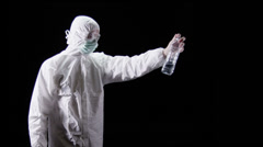 Forensic scientist on black background Stock Footage