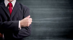 Blackboard businessman gives thumbs up with copy space Stock Footage