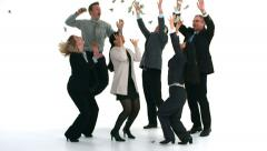 Group of businesspeople celebrate while money falls, slow motion - stock footage