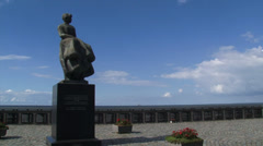 Memorial statue Urker vrouw, a memorial to lost fishermen on Urk Stock Footage