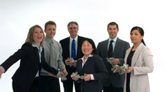 Group of businesspeople celebrate and throw money, white background - stock footage