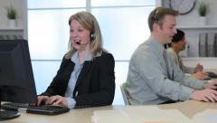 Customer service people working in office - stock footage