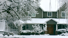 Snow falling on home in winter - stock footage