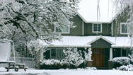 Stock Video Footage of Snow falling on home in winter