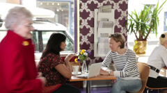 Two senior women in cafe. Group of people enjoying cafe culture and relaxing Stock Footage