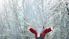 Santa Claus throwing snow into air slow motion Stock Footage
