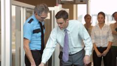 Businessman is inspected by airport security Stock Footage