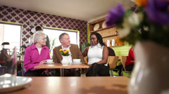 Group of people in a cafe.  A relaxed scene in busy city cafe. Stock Footage