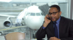 Business man works at airport Stock Footage
