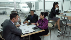 Business people having meeting at airport Stock Footage