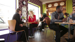 Business lunch for city working people. A relaxed cafe or restaurant setting - stock footage
