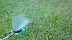 sprinkler watering green lawn - stock footage