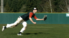 Baseball player catching ball, slow motion Stock Footage