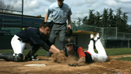 Stock Video Footage of Baseball player slides into home plate, slow motion