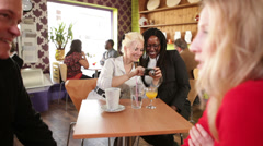 Female friends having fun in cafe restaurant. Two women share a memory and Stock Footage
