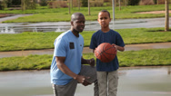 Stock Video Footage of Father teaching son to shoot basketball