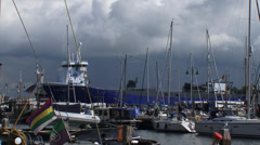Dark sky above Urk harbor + large industrial ship Atlantic Dawn + zoom ou Stock Footage
