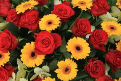 Yellow and red flowers in a bridal arrangement Stock Photos