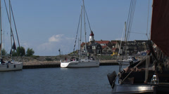 Yacht arrives at Urk harbor, The Netherlands Stock Footage