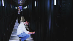 IT Technicians in data center. People working in computer server room data Stock Footage
