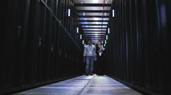 IT Technicians in data center. People working in computer server room data - stock footage