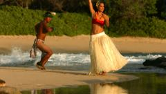 Polynesian dancers perform at beach in Hawaii, slow motion Stock Footage