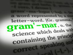 Dictionary - Grammar - Green On White - stock photo