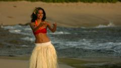 Polynesian hula dancer performs by ocean, slow motion Stock Footage