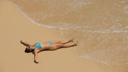 Stock Video Footage of Woman laying on beach relaxing
