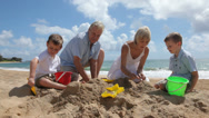 Stock Video Footage of Grandparents play with grandchildren at beach