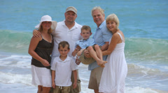 Portrait of multi-generation family at beach - stock footage
