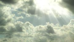 Sun beams shining trough moving clouds timelapse Stock Footage