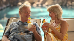 Senior couple at tropical resort Stock Footage