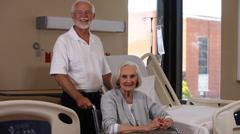 Portrait senior man and elderly woman in wheelchair Stock Footage
