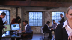 Stock Video Footage of Small Business.  Casual downtown workers in chic loft or warehouse offices.