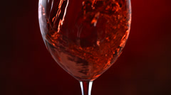 Red wine pouring, slow motion Stock Footage